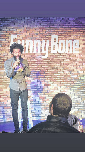 Urbana native Damon Darling is shown performing stand-up comedy at the Funny Bone in Columbus. He'll be in Urbana on Saturday for a performance on the Wing Bar's patio.