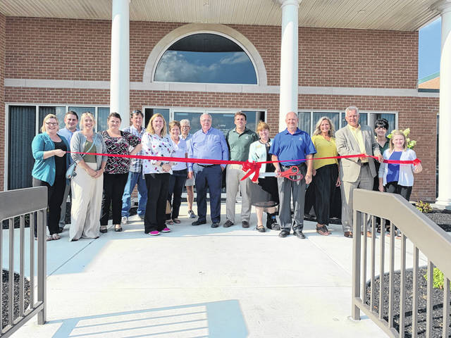 Security National Bank held a ribbon-cutting following the renovation of its teller line and front entrance and a Business After Hours event on Aug. 15. From left are Natasha Ridenour, Will Foreman, Ashley Mershon, Brittany Lewis, Mark Westfall, Jill Steinmetz, Marcia Bailey, Gary Schenkel, Jeff Darding. Jeremy Sigler, Terri Belliveau, Jeff Williams, Dana Bennett, John Brown, Rachel Casey and Sara Neer.