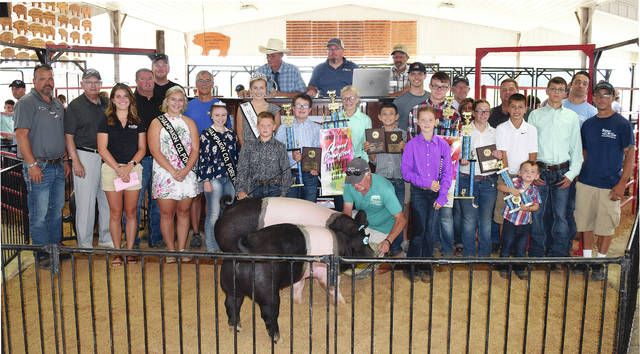 Ava Astorino won both the Grand Champion Overall Market Barrow and the Grand Champion Overall Market Gilt during junior fair competition this week. She was permitted to sell one of the champs in Thursday's junior fair swine sale. Buyers pooled together to raise $4,750 to recognize Astorino's overall great week at the fair. Those buyers were: Chad Burroughs, Obers Lawn Care, Seed Consultants, Maurice Farms, Zirkle Farms, Kyle Springer Construction, Calland Ag Transport, Champaign County Sheriff Matt Melvin, Airport Cafe, McGuire AG, Glaser's Soft Water, BNFS Insurance, Sunrise Co-Op, Tullis Farms, Civista Bank, Ward Farm Services, Bishop Farms, King Family, Perpetual Federal Savings Bank, Faulkner Show Stock, Joby/Trista Havens, Nott Show Pigs/Lindner Show Pigs and CCFS LLC. Watch Saturday's newspaper for other top swine sale photos.