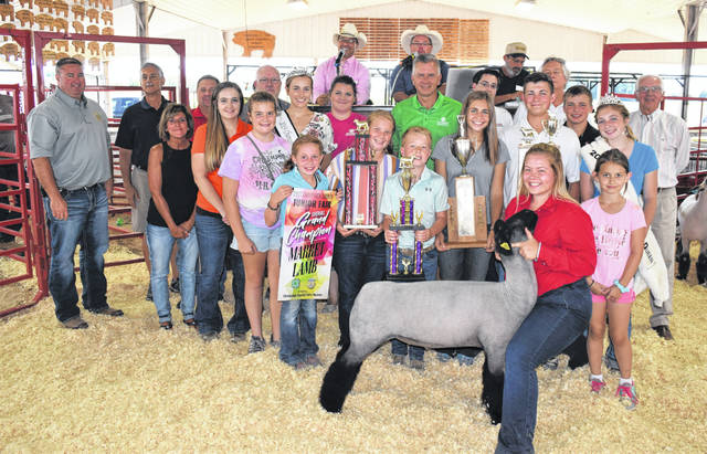 Hanna DeLong's Champion Market Lamb sold for $2,300 to a large group of buyers during Friday's junior fair sale. Delong was also the lamb Showman of Showmen.