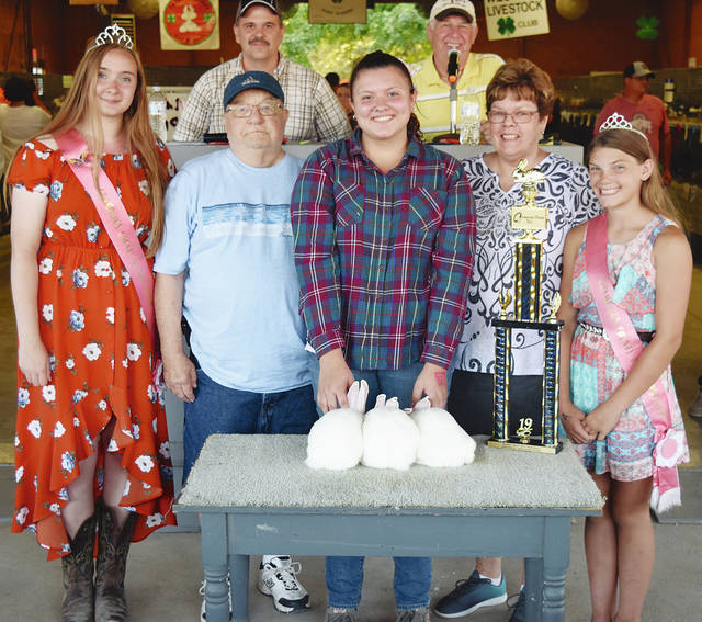 Gracie Stalnaker's Champion Meat Pen rabbit project sold to Terry and JoAnn Griest for $350.