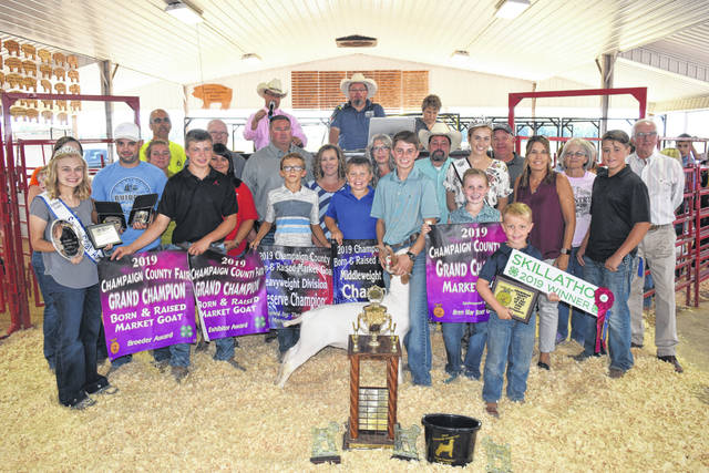 Lane Hollingsworth's Champion Market goat sold for $2,175 to a syndicate of buyers during the Junior Fair Market Goat Sale on Friday.