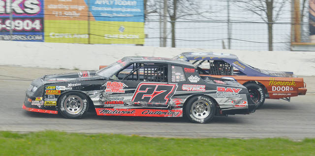 Josh Poore (27) and Buck Purtee battle in last year's CRA event at Shady Bowl. Poore is a top runner in the CRA series, while Purtee has won the last two Amsoil Series street stock features at Shady Bowl.