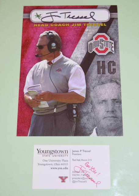 The Jim Tressel autographed piece pictured above, along with Ohio State football tickets, will be auctioned off Friday night during the Cancer Association of Champaign County's Suumer Breeze event at the Woodruff Farm (formerly Rothschild's). The event is sold out.