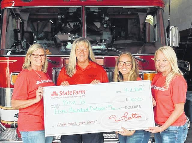 In honor of 9/11, Erin Patton State Farm donated $500 to Box 13, which has assisted the Urbana Fire Division more than 50 years. Box 13 is funded only with donations. Pictured are, from left, Holly Curnutte, Cheryl Wears, Erin Patton and Lori Troyer.