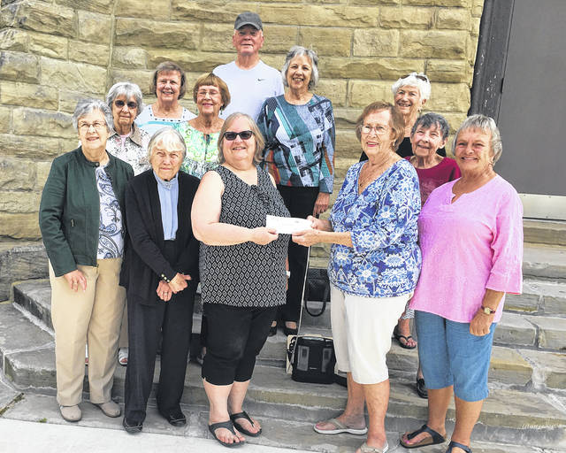 Pictured are, from left in first row, Becky Michaels Shultz, Class of 1952, Janet McKnight Yost, 1951, Kay Markley Schenkel, 1977, treasurer of the Alumni Association, Ruth Ann Cousins Branch, 1956, treasurer of the 50s Decade Reunion Committee, Sarah Jones Green-Watkins, 1959, from left in second row, Janet Shambaugh Anderson, 1952, Miriam Lowry Wertenberger, 1953, Rosa Lingrell Giampetro, 1956, from left in third row, Pat Laird Sprague, 1958, Linda Asterino Berube, 1957, Carolyn Dorsey Spellman, 1957, and back row, Ralph Chapman, 1957.
