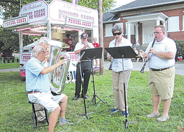 Entertainment at the Champaign County Historical Society's Oktoberfest on Oct. 6 will include a strolling German-style band. From left are Dan Walter, Dave Martin and Bob Day, Karen Hayden, David Sapp. Jeff Buehl will replace Bob Day on trumpet this year.