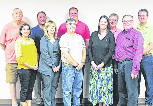 The Urbana Lions Club's board and officers for 2019-2020 are, from left in back row, Woody Bennett, vice president; Ben Headlee, officer; Zac Fiely, past president; Wayne Smith, officer; Jeff Hendricks, officer; from left in front row, Jenny White, secretary; Elaine Dyar, officer; Bob Nuzum, treasurer; Audra Bean, membership chair; Bill Bean, president.