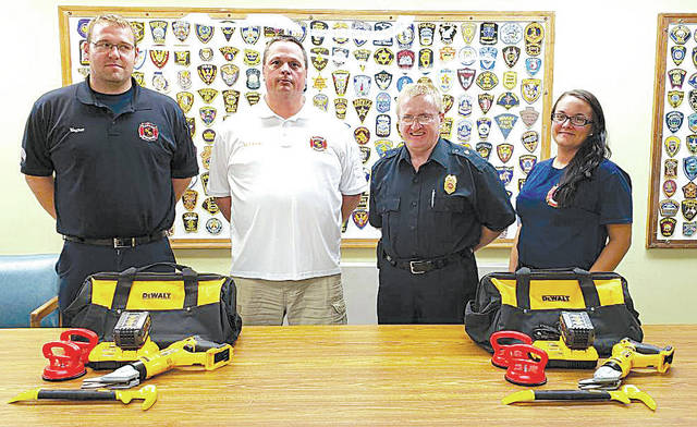 The Mechanicsburg Fire Department recently took delivery of rescue equipment that will greatly enhance their capability of vehicle extrication. The equipment, which consist of two heavy duty battery-powered windshield cutters will allow for easier and more timely access to entrapped victims of motor vehicle accidents. The new equipment was made possible by the kind generosity of the Goshen Eagles, who provided the necessary funding for the project. Pictured with the equipment is (left to right) Lieutenant Mike Wagner, Fire Chief Robert Keene, Assistant Fire Chief Steve Castle, and EMT Kristin Koester.