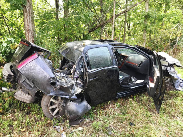 The driver of this Cadillac was seriously injured when his car left the roadway and struck several trees on Friday afternoon.