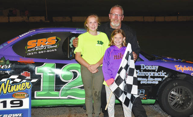 Jeremy Niswonger of Urbana is joined by the children of Chris Holbrook in victory lane Saturday night at Shady Bowl. Holbrook, who was a member of Niswonger's Noble Armor Coating crew, passed away suddenly three weeks ago.