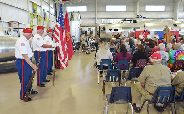 Pictured are ceremonies held during a previous Remembrance Day at the Champaign Aviation Museum.