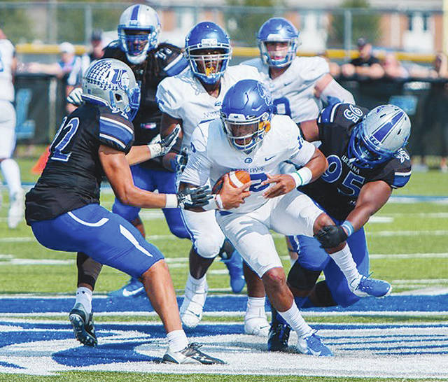 UU's Mike Young (left) and Wendell Wheeler drag down Notre Dame College quarterback Chris Brimm during Saturday's game at UU.