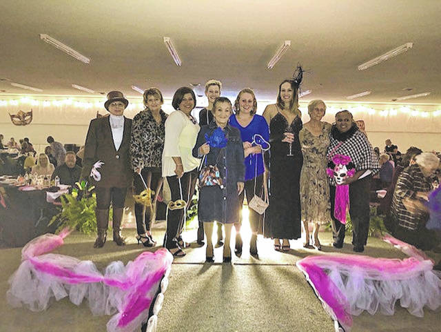 The nine models for this year's Fashions to a Tea, all breast cancer survivors, were, from left, Kay Sine, Carol White, Dr Sharon Heisler, Heather Smith, Julie Hablitzel, Jordan Hux, Holly Suchland, Jan Blanton, and Ce Greene.