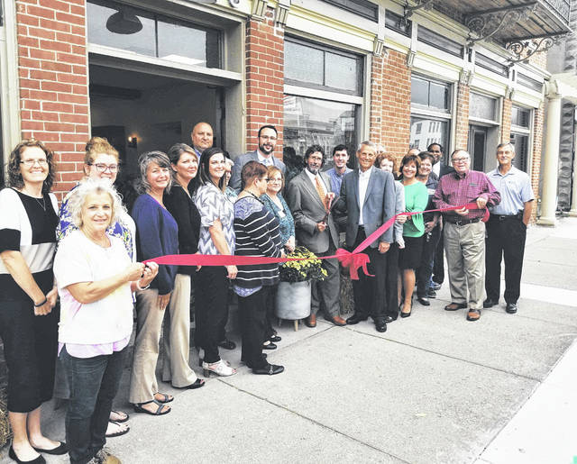 Wallace & Turner Insurance, Springfield, opened a second location at 113 Scioto St. in Urbana this month. The Chamber of Commerce held a ribbon-cutting at the site, the former Sowles Hotel. Assisting with the welcome were, from left, Vicki Deere-Bunnell, Kara Stephens, Emily Dinnen, Chris Johnston, Laura Londergan, Stephanie Geis, Judy Kirkpatrick, Monica Gibson, Lisa Webb, Jason Heims, Myles Trempe, Patrick Field, Wallace & Turner partner, P.J. Miller, Wallace & Miller partner, Zach Vaughn, Gail Bennington, Lisa Miller, Marcia Bailey, Gary Weaver, Bill Bean and Greg Knight.