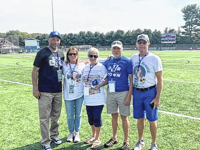 Honoring Phil Shetler during the Sept. 28 halftime show are, from left, Dr. Christopher Washington, Bev Titus, Janet Shetler, John Titus and Bill Titus.