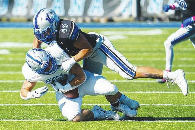 Urbana University linebacker LA Kelly (46) makes a tackle during a recent game.