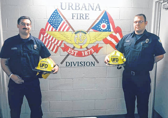 Firefighters Douglas Sprankle, left, and Michael Wagner, right, are new members of the Urbana Fire Division.