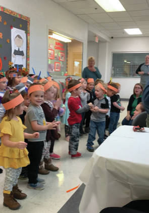 Children perform at the Champaign Family YMCA's annual preschool family feast on Thursday.