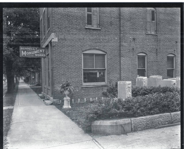 Then – This is a circa 1930 photo (#0183) of the Bunnell Monument Works at 113 E. Church St., reported to be oldest continuous business in Urbana. It was founded in 1868 by D.M. Bunnell. The building was built the same year. The business was acquired by John Enright in the late 1940s. At that time the name of the business was changed to Urbana Monument Company.