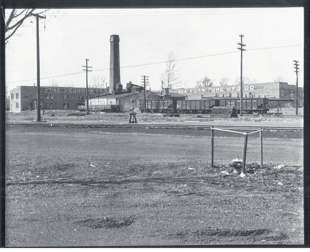 Then - This circa 1930 photo is of the Urbana Furniture Company, which once occupied the corner of South Oakland and Beach streets.