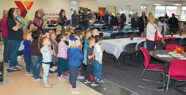 The Champaign Family YMCA pre-school class led attendees of the annual veterans brunch in the Pledge of Allegiance on Thursday. Veterans were treated to a breakfast of pancakes, scrambled eggs and sausage while the Champaign County Dulcimer Club played patriotic music. YMCA board member and Air Force veteran Phil Edwards greeted veterans at the door.