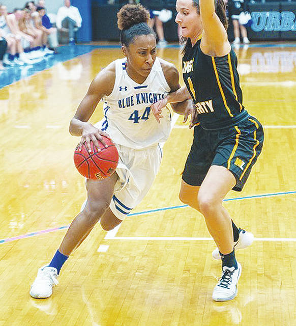 UU's Tyra James (left) drives against West Liberty University on Saturday. James had a triple-double in the Blue Knights' win.