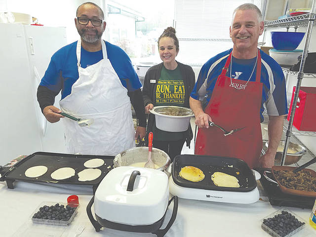 From left are Gulf War veteran and YMCA employee Charles Williams, Y Camp and School Age Child Care Director Nicky Naylor and Jerry Fetherolf, event co-organizer.