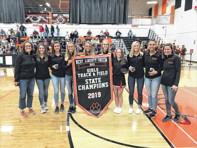 The WL-S state championship girls track team was recently honored. Pictured left to right are Head Coach Ann Vogel, Katelyn Stapleton, Madison Bahan, Grace Adams, Megan Adams, Lydia Moell, Kaylee LeVan, Grace Estes, Alex Burton and Assistant Coach Mandy Lauck.