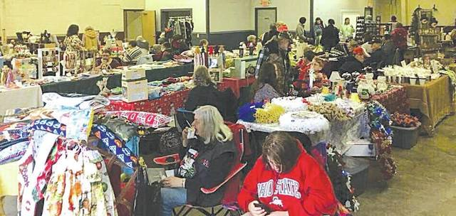 This photo shows vendors at last year's Christmas in the Village craft show in the St. Paris municipal building.