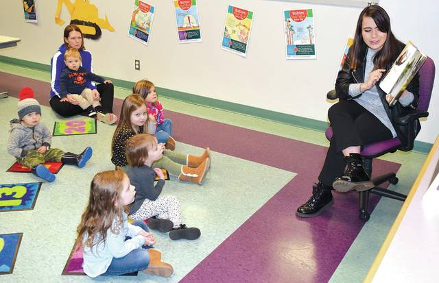 """Librarian Keara Henry reads the book """"Chewie and the Porgs"""" to children at the Champaign County Library on Tuesday, the last scheduled story time of 2019. Starting in January, children can be signed up for 2020 story times. Visit the library or call 937-653-3811."""