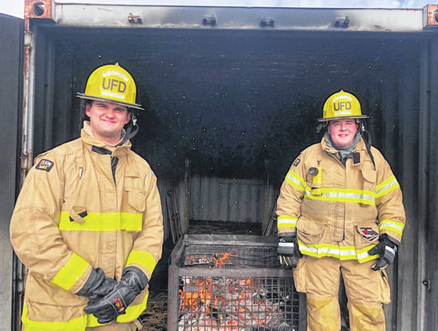 The Urbana Fire Division's two newest firefighters are Erik Vondenhuevel, left, and Dillon Stevens, right.