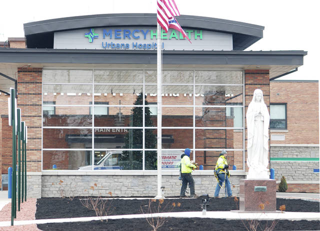 A new patient-friendly front entrance on Mercy Health - Urbana Hospital will be dedicated on Monday, with activities also including an open house at the hospital. Workers are shown on Friday putting the finishing touches on the project.