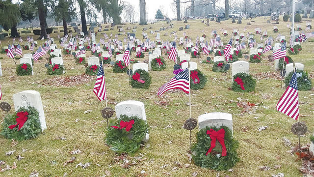 Wreaths Across America decorations are shown at Soldiers' Mound in Oak Dale Cemetery in Urbana.