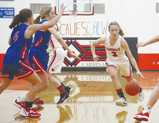 Triad's Olivia Butz (right) drives against Riverside on Saturday at THS.