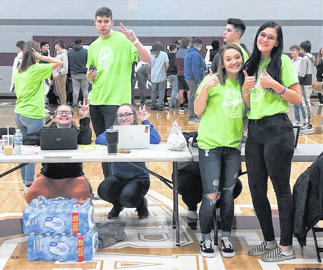 DECA members including Grant Hower (background), Tessa Armstrong and Sky Schelde (front) are pictured during the mental health fair.