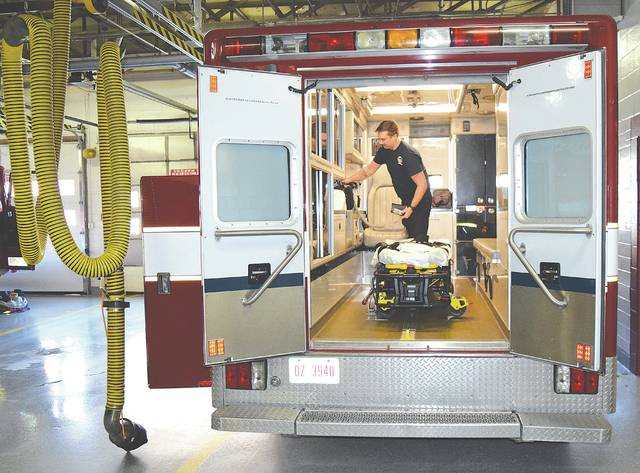 Firefighter/Medic Douglas Sprankle of the Urbana Fire Division prepares an ambulance for service on Monday afternoon.