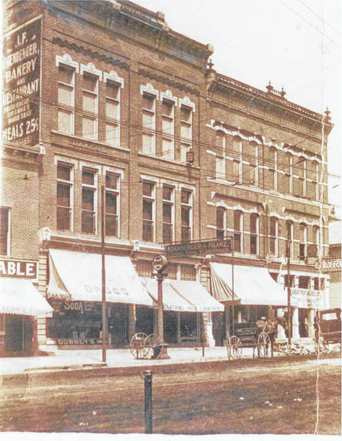 Then - This 1910 photo shows the Egenberger Building at 114-116 S. Main St., Urbana.