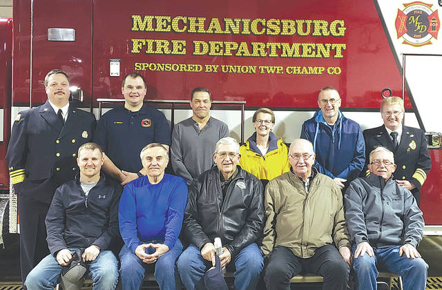 Several Union Township residents and trustees, along with Mechanicsburg's mayor and fire department leaders, took delivery of a 2020 International/McCoy Miller EMS ambulance on Jan. 17 to replace a 13-year-old vehicle. The $223,000 addition was made possible by the Union Township trustees in a gesture of appreciation for years of EMS and fire services provided to township residents by the M'burg Fire Department. Shown are, back row from left, Mechanicsburg Fire Chief Robert Keene, Lt. Matt Bebout, Union Twp. residents Gary Coffee, Linda Gordon and Douglas Castle, Asst. Fire Chief Steve Castle, front from left, M'burg Mayor Benjamin Layne, Union Twp. Trustees Chuck Dooley, Ron Williams and Jim Virts, former M'burg Mayor Greg Kimball.