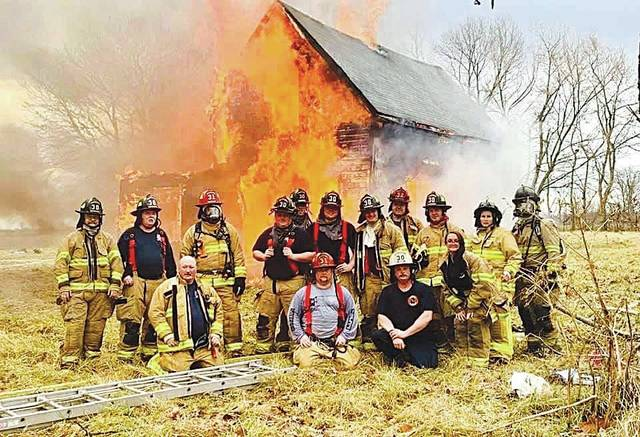 The Mechanicsburg Fire Department conducted fire training Saturday, Jan. 11, setting fire to a house at 11435 Rosedale Road owned by Woodland Farms of Mechanicsburg. Woodland Farms owner John Wing said the structure had sustained damage, making it an acceptable loss.