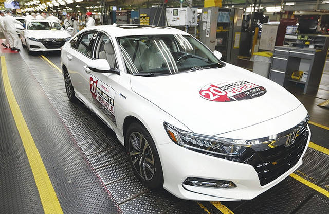 Associates cheered on Monday as a 2020 Platinum White Pearl Honda Accord Hybrid rolled off the production line at the Marysville Auto Plant, Honda's first auto plant in America.