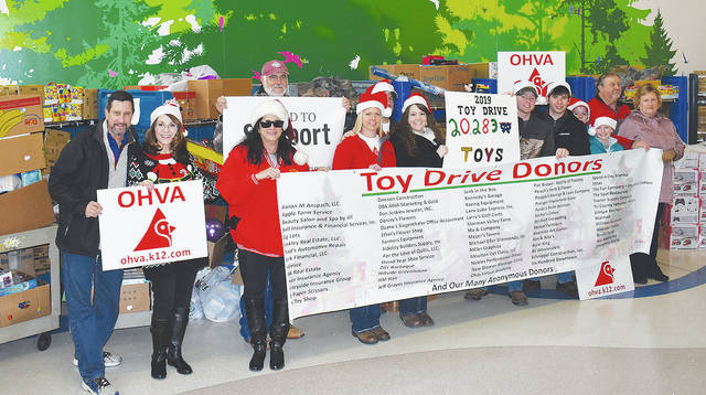 The Slaven family is shown with their volunteer crew from the Ohio Virtual Academy (OHVA) donating over 20,000 toys at Nationwide Children's Hospital in Columbus.