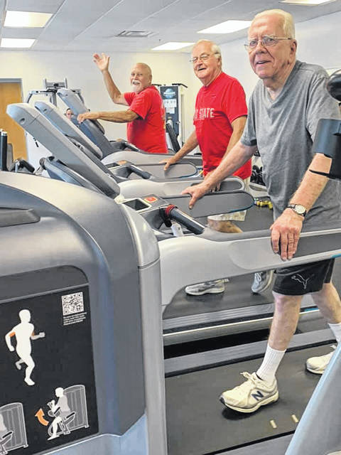 YMCA members Dave Reed, Kenny Myers, and Tom Shockey (L-R) are shown walking in the Y's fitness center.
