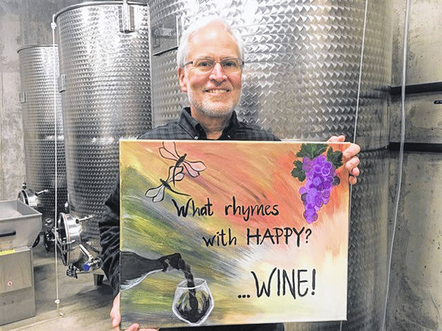 Kent Eichenauer poses with his art, and explains dragonflies have a special meaning for his family and for many of those who have experienced losses.