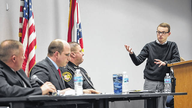 Forum moderator Taylor Armstrong (right) addresses candidates for Champaign County sheriff (from left) Chad Burroughs, David Patrick and Matt Melvin during Monday evening's Republican candidates' event at the Champaign County Community Center.