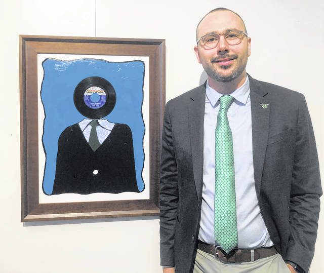 Myles Trempe poses with his art, which has its own spin!