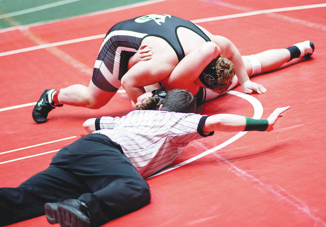 Graham's Zack Burroughs pins Aurora's Joey Arnold at 285 pounds to propel the Falcons to a 32-30 win in the semifinals of the Division II state duals on Sunday in Columbus.