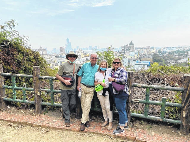 Larry and Sharon Johnson (center) are pictured with family members Dwight and Carol Holtkamp in Taiwan during one of the MS Westerdam's last tour stops before the coronavirus outbreak caused other countries to shun the ship for fear of spreading the virus.