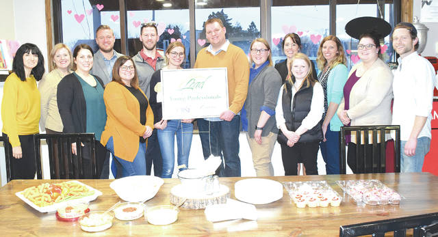 Members of iLead - Inspiring, Learning, Encouraging, and Developing Champaign County young professionals - met at the Spotted Cow Coffeehouse on Tuesday for a networking event. From left are Rachel Casey, Holly McGowen, Krista Bradley, Jamon Sellman, Staci Wisma, Jacob McKee, Bobbi McKee, Ryan Berry, Natalie Frueh, Ashley Mershon, Sara Neer, Tracy Short, Ashlee Skinner and Micah Bonsell. The chairperson of this Chamber of Commerce subcommittee, Holly McGowen, said that iLead tries to host one event every quarter highlighting local businesses. For more information about iLead visit the Facebook page or call 937-653-5764.