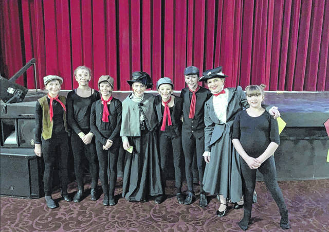 """On Tuesday, 7th and 8th grade West Liberty-Salem choir students took part in a production of """"Mary Poppins: The Musical!"""" at The Holland Theatre in Bellefontaine. Fellow choir students were in the audience. Players included, from left, Ashley Yoder, Illa Kerns, Abigail Miller, Jessa Beard, Sophia Holland, Lilly Smith, Anna Byrd as Mary Poppins, Isabelle Richards and, not pictured, Malia Miller."""